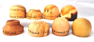 Turned wooden paperweights